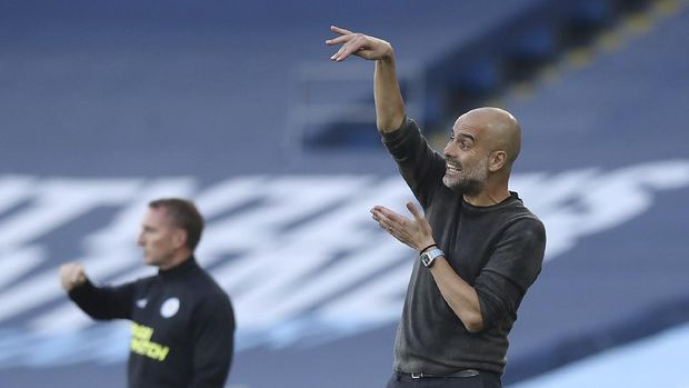 Manchester City's head coach Pep Guardiola, right gestures to his players during the English Premier League soccer match between Manchester City and Leicester City at the Etihad stadium in Manchester, England, Sunday, Sept. 27, 2020. (Martin Rickett/Pool via AP)