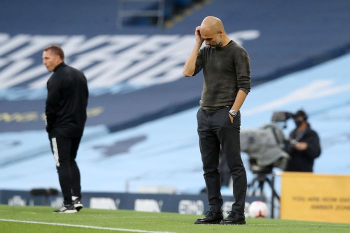 MANCHESTER, ENGLAND - SEPTEMBER 27: Pep Guardiola, Manager of Manchester City looks dejected during the Premier League match between Manchester City and Leicester City at Etihad Stadium on September 27, 2020 in Manchester, England. Sporting stadiums around the UK remain under strict restrictions due to the Coronavirus Pandemic as Government social distancing laws prohibit fans inside venues resulting in games being played behind closed doors. (Photo by Martin Rickett - Pool/Getty Images )