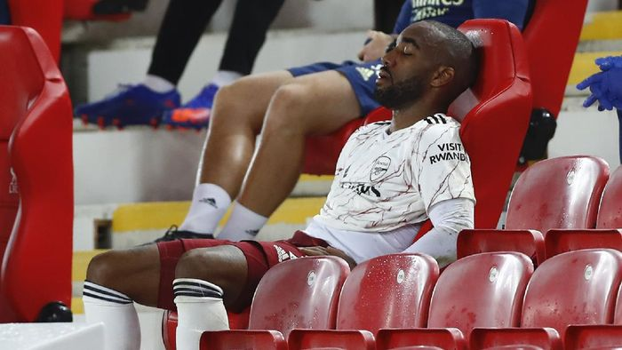 LIVERPOOL, ENGLAND - SEPTEMBER 28: Alexandre Lacazette of Arsenal looks dejected after being substituted during the Premier League match between Liverpool and Arsenal at Anfield on September 28, 2020 in Liverpool, England. Sporting stadiums around the UK remain under strict restrictions due to the Coronavirus Pandemic as Government social distancing laws prohibit fans inside venues resulting in games being played behind closed doors. (Photo by Jason Cairnduff - Pool/Getty Images)