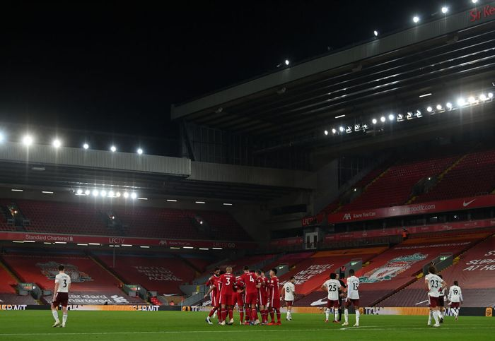 LIVERPOOL, ENGLAND - SEPTEMBER 28: A general view inside the stadium as Diogo Jota of Liverpool celebrates with teammates after scoring his sides third goal during the Premier League match between Liverpool and Arsenal at Anfield on September 28, 2020 in Liverpool, England. Sporting stadiums around the UK remain under strict restrictions due to the Coronavirus Pandemic as Government social distancing laws prohibit fans inside venues resulting in games being played behind closed doors. (Photo by Paul Ellis - Pool/Getty Images)