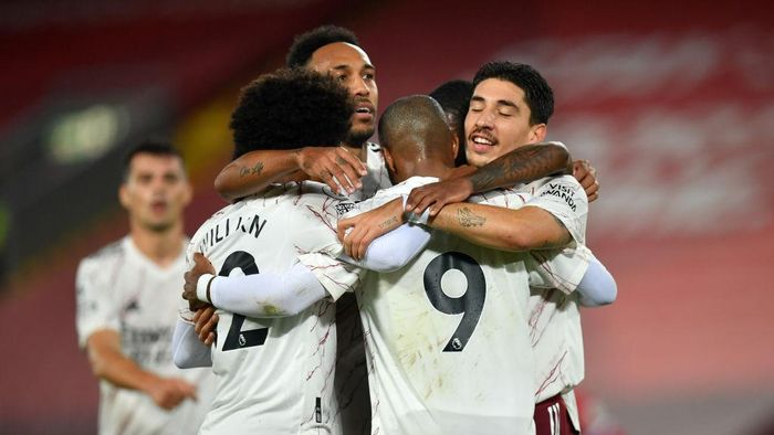 LIVERPOOL, ENGLAND - SEPTEMBER 28: Alexandre Lacazette of Arsenal celebrates with teammates after scoring his sides first goal during the Premier League match between Liverpool and Arsenal at Anfield on September 28, 2020 in Liverpool, England. Sporting stadiums around the UK remain under strict restrictions due to the Coronavirus Pandemic as Government social distancing laws prohibit fans inside venues resulting in games being played behind closed doors. (Photo by Paul Ellis - Pool/Getty Images)