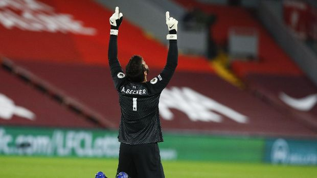 Liverpool's goalkeeper Alisson Becker reacts during the English Premier League soccer match between Liverpool and Arsenal at Anfield in Liverpool, England, Monday, Sept. 28, 2020. (Jason Cairnduff/Pool via AP)