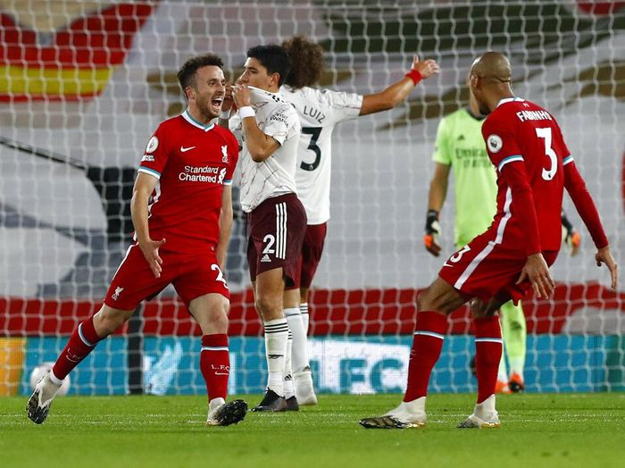 Liverpools Diogo Jota, left, is congratulated by teammate Fabinho after scoring his teams third goal during the English Premier League soccer match between Liverpool and Arsenal at Anfield in Liverpool, England, Monday, Sept. 28, 2020. (Jason Cairnduff/Pool via AP)