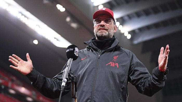 Liverpools manager Jurgen Klopp is interviewed after their English Premier League soccer match between Liverpool and Arsenal at Anfield in Liverpool, England, Monday, Sept. 28, 2020. (Laurence Griffiths/Pool via AP)