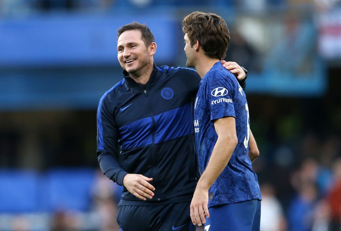 LONDON, ENGLAND - OCTOBER 19: Frank Lampard, Manager of Chelsea and Marcos Alonso of Chelsea celebrate victory following the Premier League match between Chelsea FC and Newcastle United at Stamford Bridge on October 19, 2019 in London, United Kingdom. (Photo by Paul Harding/Getty Images)