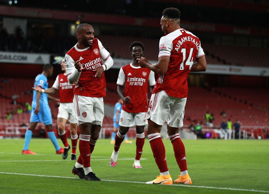 LONDON, ENGLAND - SEPTEMBER 19: Alexandre Lacazette of Arsenal celebrates with teammate Pierre-Emerick Aubameyang after scoring his team's first goal during the Premier League match between Arsenal and West Ham United at Emirates Stadium on September 19, 2020 in London, England. (Photo by Ian Walton - Pool/Getty Images)