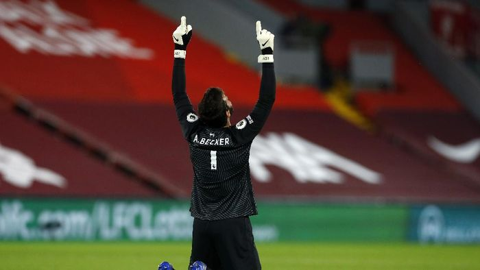 LIVERPOOL, ENGLAND - SEPTEMBER 28: Alisson Becker of Liverpool celebrates during the Premier League match between Liverpool and Arsenal at Anfield on September 28, 2020 in Liverpool, England. Sporting stadiums around the UK remain under strict restrictions due to the Coronavirus Pandemic as Government social distancing laws prohibit fans inside venues resulting in games being played behind closed doors. (Photo by Jason Cairnduff - Pool/Getty Images)