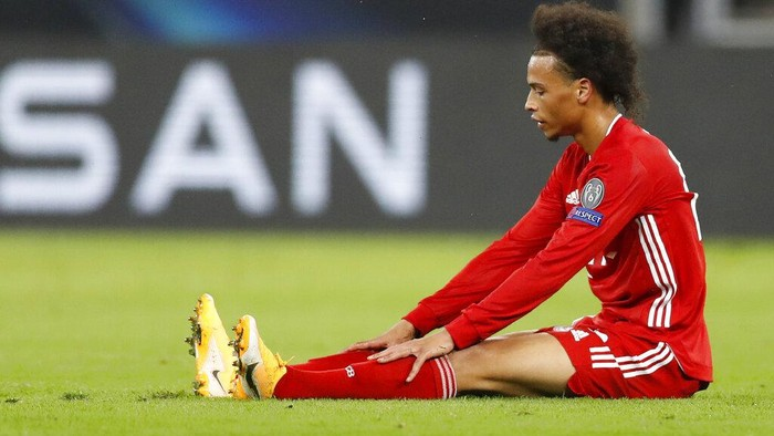 Bayerns Leroy Sane sits on the pitch during the UEFA Super Cup soccer match between Bayern Munich and Sevilla at the Puskas Arena in Budapest, Hungary, Thursday, Sept. 24, 2020. (AP Photo/Laszlo Balogh, Pool)