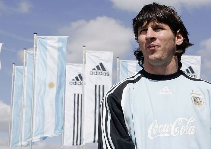 HERZOGENAURACH, GERMANY - JUNE 04:  Lionel Messi of Argentina stands in front of flags at the World of Sports Stadium on June 4, 2006 in Herzogenaurach, Germany  (Photo by Jan Pitman/Getty Images for Adidas)