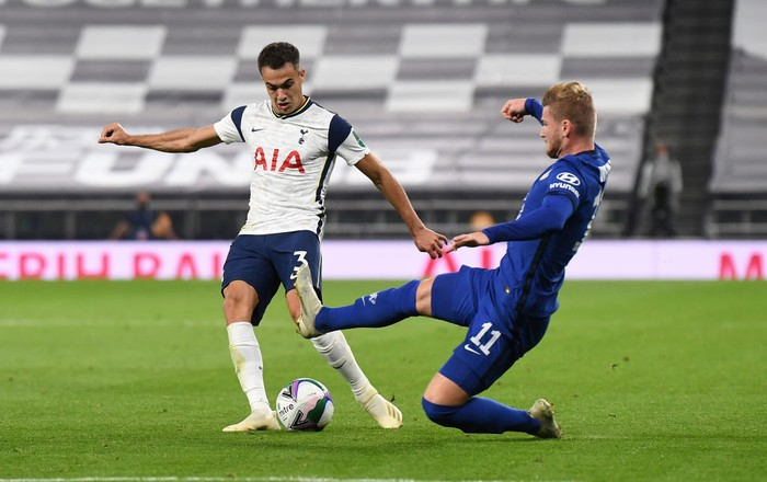 LONDON, ENGLAND - SEPTEMBER 29: Timo Werner of Chelsea tackles Sergio Reguilon of Tottenham Hotspur during the Carabao Cup fourth round match between Tottenham Hotspur and Chelsea at Tottenham Hotspur Stadium on September 29, 2020 in London, England. Football Stadiums around United Kingdom remain empty due to the Coronavirus Pandemic as Government social distancing laws prohibit fans inside venues resulting in fixtures being played behind closed doors. (Photo by Neil Hall - Pool/2020 Getty Images)