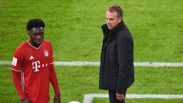 MUNICH, GERMANY - SEPTEMBER 30: Bayern Munichs Alphonso Davies and coach Hansi Flick during the Supercup 2020 match between FC Bayern München and Borussia Dortmund at Allianz Arena on September 30, 2020 in Munich, Germany. (Photo by Andreas Gebert - Pool/Getty Images )