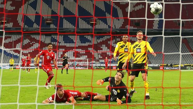 MUNICH, GERMANY - SEPTEMBER 30: Joshua Kimmich of FC Bayern Munich scores his sides third goal during the Supercup 2020 match between FC Bayern Muenchen and Borussia Dortmund at Allianz Arena on September 30, 2020 in Munich, Germany.  (Photo by Alexander Hassenstein/Getty Images )
