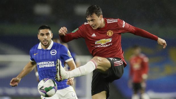 Manchester United's Victor Lindelof kicks the ball during the English League Cup fourth round soccer match between Brighton and Manchester United at Falmer Stadium in Brighton, England, Wednesday, Sept. 30, 2020. (Matt Dunham/Pool via AP)