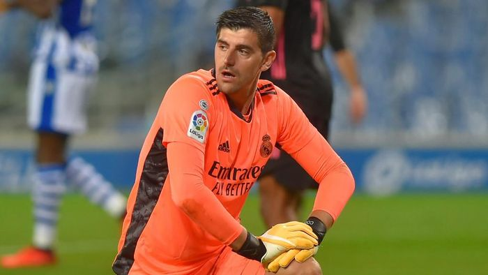 Real Madrids Belgian goalkeeper Thibaut Courtois kneels during the Spanish league football match between Real Sociedad and Real Madrid at the Anoeta stadium in San Sebastian on September 20, 2020. (Photo by ANDER GILLENEA / AFP)
