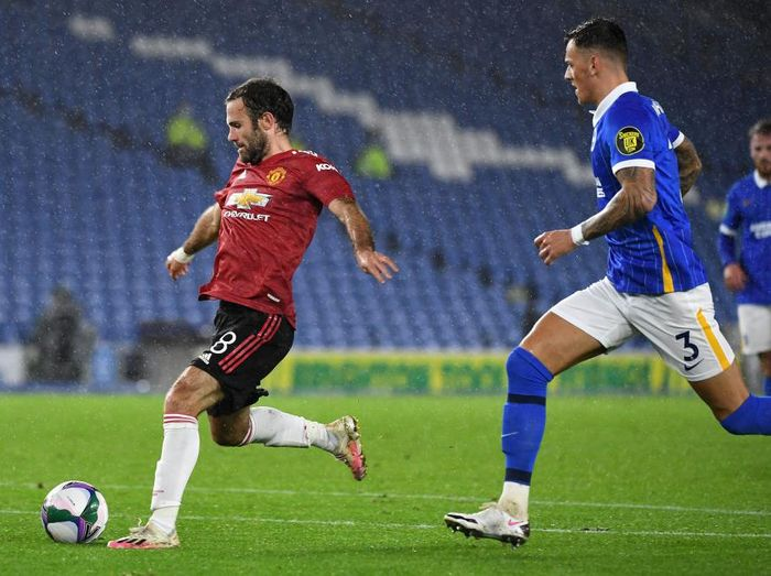 BRIGHTON, ENGLAND - SEPTEMBER 30: Juan Mata of Manchester United scores his sides second goal during the Carabao Cup fourth round match between Brighton and Hove Albion and Manchester United at Amex Stadium on September 30, 2020 in Brighton, England. Football Stadiums around United Kingdom remain empty due to the Coronavirus Pandemic as Government social distancing laws prohibit fans inside venues resulting in fixtures being played behind closed doors. (Photo by Andy Rain - Pool/Getty Images)
