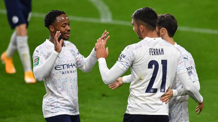BURNLEY, ENGLAND - SEPTEMBER 30: Ferran Torres of Manchester City celebrates with teammates after scoring his sides third goal during the Carabao Cup fourth round match between Burnley and Manchester City at Turf Moor on September 30, 2020 in Burnley, England. Football Stadiums around United Kingdom remain empty due to the Coronavirus Pandemic as Government social distancing laws prohibit fans inside venues resulting in fixtures being played behind closed doors. (Photo by Paul Ellis - Pool/Getty Images)