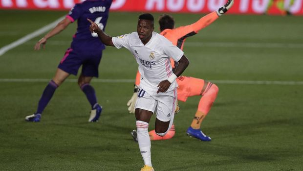 Real Madrid's Vinicius Junior runs to celebrate after scoring during the Spanish La Liga soccer match between Real Madrid and Valladolid at Alfredo di Stefano stadium in Madrid, Spain, Wednesday, Sept. 30, 2020. (AP Photo/Manu Fernandez)