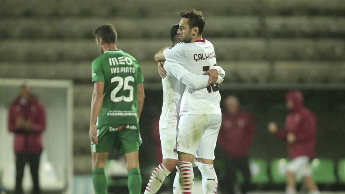 AC Milans Hakan Calhanoglu, right, celebrates after scoring his sides second goal from the penalty spot during the Europa League playoff soccer match between Rio Ave FC and AC Milan in Vila do Conde, Portugal, Thursday, Oct. 1, 2020. (AP Photo/Luis Vieira)