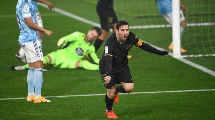 VIGO, SPAIN - OCTOBER 01: Lionel Messi of Barcelona  celebrates after scoring his team second goal during the La Liga Santander match between RC Celta and FC Barcelona at Abanca-Balaídos on October 01, 2020 in Vigo, Spain. Football Stadiums around Europe remain empty due to the Coronavirus Pandemic as Government social distancing laws prohibit fans inside venues resulting in fixtures being played behind closed doors. (Photo by Octavio Passos/Getty Images)