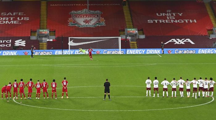 Arsenals goalkeeper Bernd Leno saves a penalty from Liverpools Divock Origi during the English League Cup fourth round soccer match between Liverpool and Arsenal at Anfield, Liverpool, England, Thursday, Oct. 1, 2020. (Laurence Griffiths/Pool via AP)