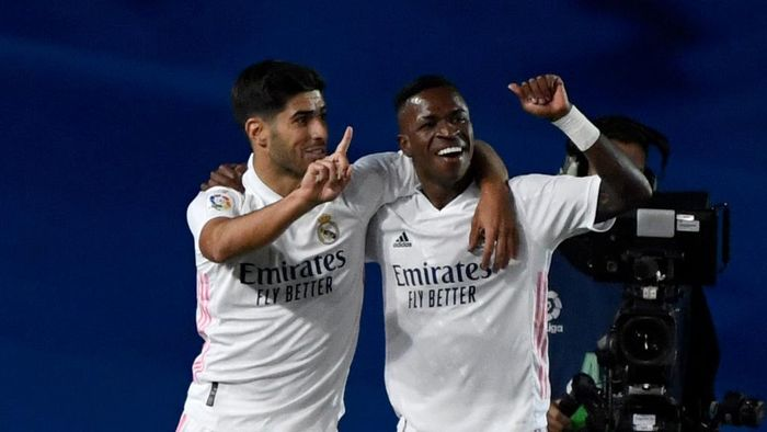 Real Madrids Brazilian forward Vinicius Junior (R) celebrates with Real Madrids Spanish midfielder Marco Asensio after scoring during the Spanish league football match Real Madrid CF against Real Valladolid FC at the Alfredo di Stefano stadium in Valdebebas, on the outskirts of Madrid on September 30, 2020. (Photo by PIERRE-PHILIPPE MARCOU / AFP)