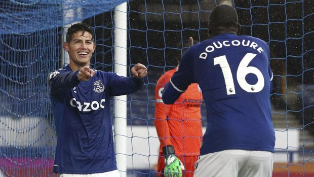 Everton's James Rodriguez, left, celebrates after scoring his side's fourth goal during the English Premier League soccer match between Everton and Brighton at the Goodison Park stadium in Liverpool, England, Saturday, Oct. 3, 2020. (Jan Kruger/Pool via AP)