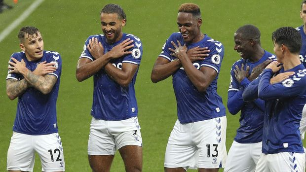 Everton's Yerry Mina celebrates after scoring his side's second goal during the English Premier League soccer match between Everton and Brighton at the Goodison Park stadium in Liverpool, England, Saturday, Oct. 3, 2020. (Peter Byrne/Pool via AP)