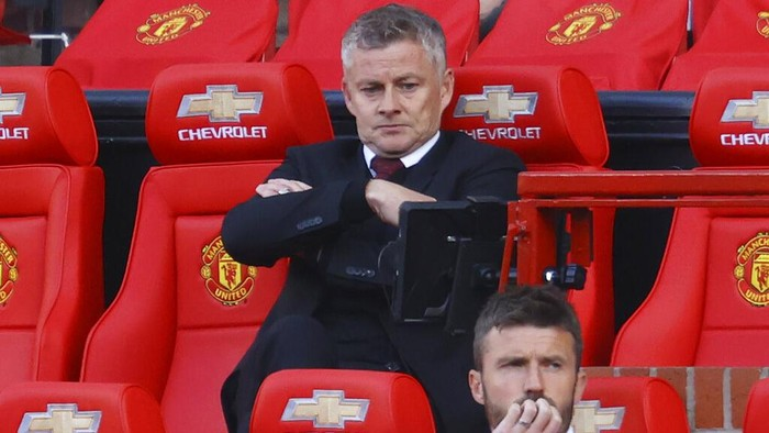 Manchester United manager Ole Gunnar Solskjaer appears dejected during the English Premier League soccer match between Manchester United and Crystal Palace at the Old Trafford stadium in Manchester, England, Saturday, Sept. 19, 2020. (Richard Heathcote/Pool via AP)