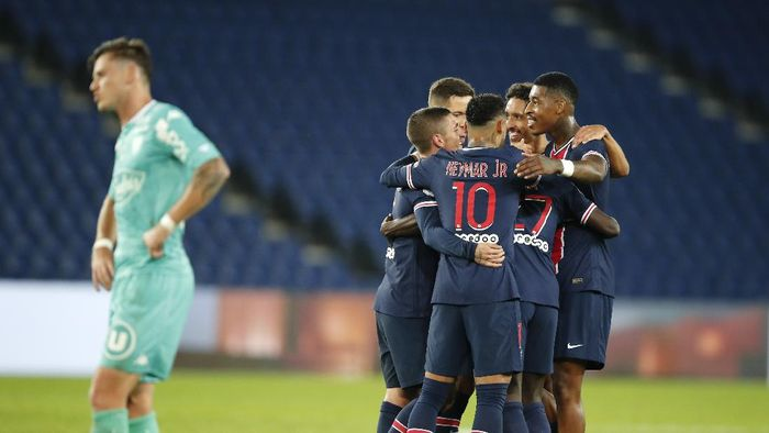 PSG players celebrate after Idrissa Gueye scored their sides 5th goal during the French League One soccer match between Paris Saint-Germain and Angers at the Parc des Princes in Paris, France, Friday, Oct. 2, 2020. (AP Photo/Francois Mori)