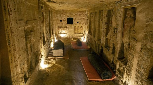 Several sarcophagi are displayed inside a tomb at the Saqqara archaeological site, 30 kilometers (19 miles) south of Cairo, Egypt, on Saturday, Oct. 3, 2020. Egypt's ministry of antiquities and tourism says at least 59 sealed sarcophagi with mummies inside were found in three wells, and are believed to have been buried there more than 2,600 years ago. (APPhoto/Mahmoud Khaled)