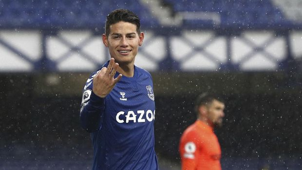 Everton's James Rodriguez celebrates after scoring his side's fourth goal during the English Premier League soccer match between Everton and Brighton at the Goodison Park stadium in Liverpool, England, Saturday, Oct. 3, 2020. (Jan Kruger/Pool via AP)