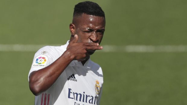 Real Madrid's Vinicius Junior celebrates after scoring the opening goal during the Spanish La Liga soccer match between Levante and Real Madrid at the Ceramica stadium in Villarreal, Spain, Sunday, Oct. 4, 2020. (AP Photo/Jose Miguel Fernandez)