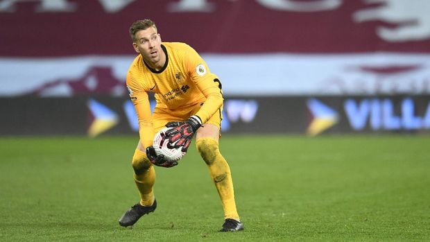 Liverpool's goalkeeper Adrian played the ball during the English Premier League soccer match between Aston Villa and Liverpool at the Villa Park stadium in Birmingham, England, Sunday, Oct. 4, 2020. (Peter Powell/Pool via AP)