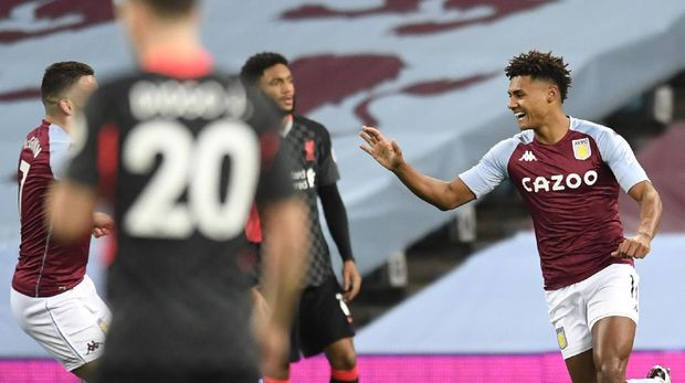 Aston Villa's Ollie Watkins, right, celebrates with his teammates after scoring his side's opening goal during the English Premier League soccer match between Aston Villa and Liverpool at the Villa Park stadium in Birmingham, England, Sunday, Oct. 4, 2020. (Cath Ivill/Pool via AP)