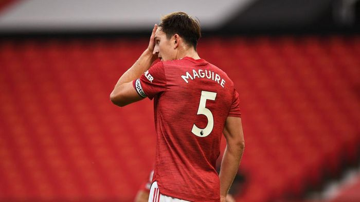 MANCHESTER, ENGLAND - OCTOBER 04: Harry Maguire of Manchester United reacts during the Premier League match between Manchester United and Tottenham Hotspur at Old Trafford on October 04, 2020 in Manchester, England. Sporting stadiums around the UK remain under strict restrictions due to the Coronavirus Pandemic as Government social distancing laws prohibit fans inside venues resulting in games being played behind closed doors. (Photo by Oli Scarff - Pool/Getty Images)