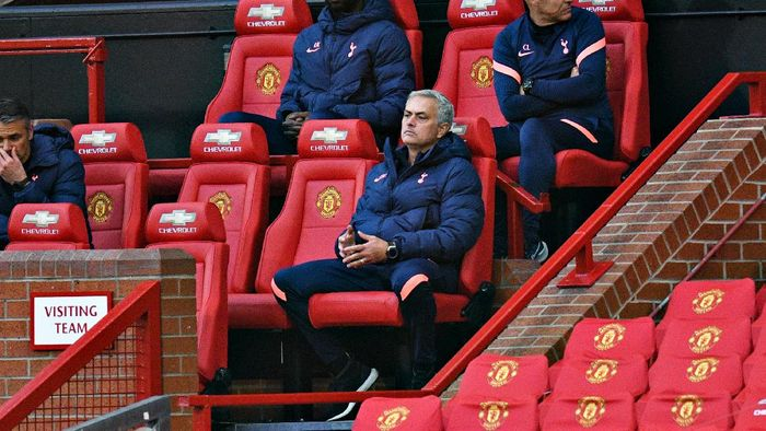 MANCHESTER, ENGLAND - OCTOBER 04: Jose Mourinho, Manager of Tottenham Hotspur looks on from the bench during the Premier League match between Manchester United and Tottenham Hotspur at Old Trafford on October 04, 2020 in Manchester, England. Sporting stadiums around the UK remain under strict restrictions due to the Coronavirus Pandemic as Government social distancing laws prohibit fans inside venues resulting in games being played behind closed doors. (Photo by Oli Scarff - Pool/Getty Images)