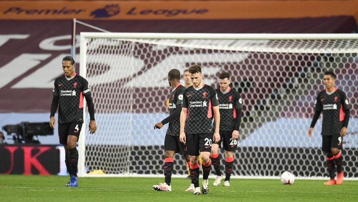 Liverpool players react after Aston Villas Ollie Watkins scores his sides fourth goal during the English Premier League soccer match between Aston Villa and Liverpool at the Villa Park stadium in Birmingham, England, Sunday, Oct. 4, 2020. (Peter Powell/Pool via AP)