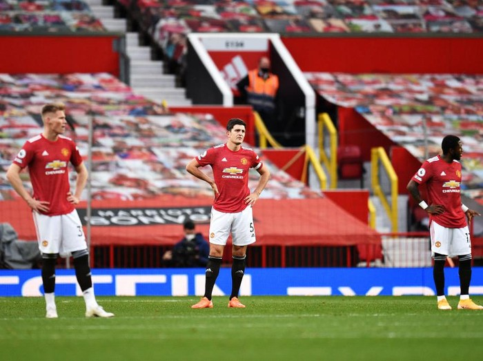 MANCHESTER, ENGLAND - OCTOBER 04: Harry Maguire of Manchester United looks dejected during the Premier League match between Manchester United and Tottenham Hotspur at Old Trafford on October 04, 2020 in Manchester, England. Sporting stadiums around the UK remain under strict restrictions due to the Coronavirus Pandemic as Government social distancing laws prohibit fans inside venues resulting in games being played behind closed doors. (Photo by Oli Scarff - Pool/Getty Images)