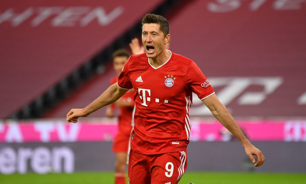 MUNICH, GERMANY - OCTOBER 04: Robert Lewandowski of Bayern Munich  celebrates after scoring his team's third goal  during the Bundesliga match between FC Bayern Muenchen and Hertha BSC at Allianz Arena on October 04, 2020 in Munich, Germany. (Photo by Sebastian Widmann/Getty Images)
