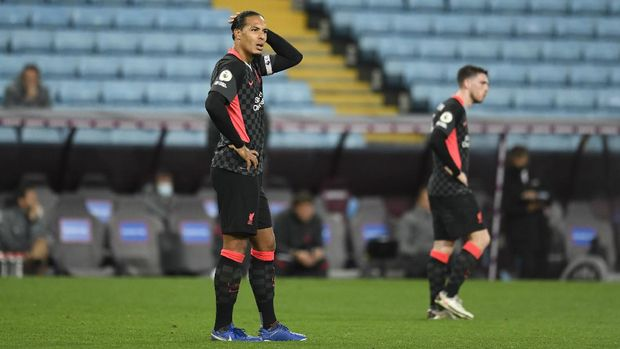 BIRMINGHAM, ENGLAND - OCTOBER 04: Virgil van Dijk of Liverpool reacts after Aston Villa score their 7th goal during the Premier League match between Aston Villa and Liverpool at Villa Park on October 04, 2020 in Birmingham, England. Sporting stadiums around the UK remain under strict restrictions due to the Coronavirus Pandemic as Government social distancing laws prohibit fans inside venues resulting in games being played behind closed doors. (Photo by Peter Powell - Pool/Getty Images)