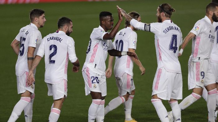 Real Madrids Vinicius Junior, center, celebrates with his teammates after scoring during the Spanish La Liga soccer match between Real Madrid and Valladolid at Alfredo di Stefano stadium in Madrid, Spain, Wednesday, Sept. 30, 2020. (AP Photo/Manu Fernandez)