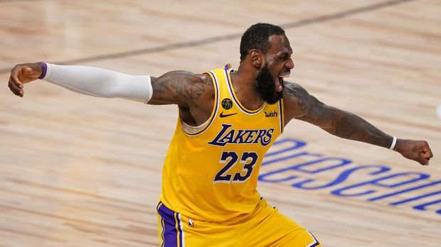 Los Angeles Lakers forward LeBron James celebrates during the second half in Game 4 of basketball's NBA Finals against the Miami Heat Tuesday, Oct. 6, 2020, in Lake Buena Vista, Fla. (AP Photo/Mark J. Terrill)