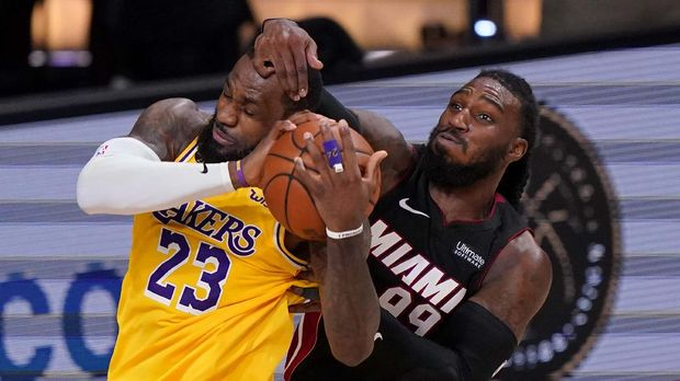 Los Angeles Lakers forward LeBron James and Miami Heat forward Jae Crowder battle for a rebound during the second half in Game 4 of basketball's NBA Finals Tuesday, Oct. 6, 2020, in Lake Buena Vista, Fla. (AP Photo/Mark J. Terrill)