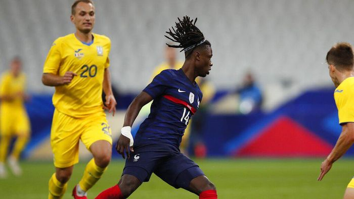 Frances Eduardo Camavinga controls the ball during their friendly international soccer maths between France and Ukraine at the Stade deFrance in Saint Denis, north of Paris, Wednesday Oct. 7, 2020. (AP Photo/Francois Mori)