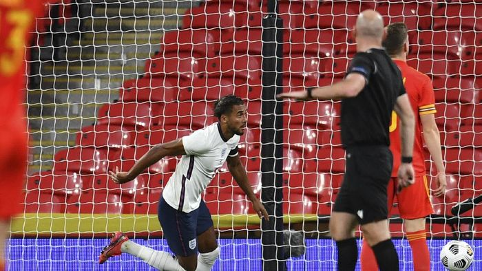 Englands Dominic Calvert-Lewin, center, runs to celebrate after scoring during the international friendly soccer match between England and Wales at Wembley stadium in London, Thursday Oct. 8, 2020. (Glynn Kirk/Pool via AP)