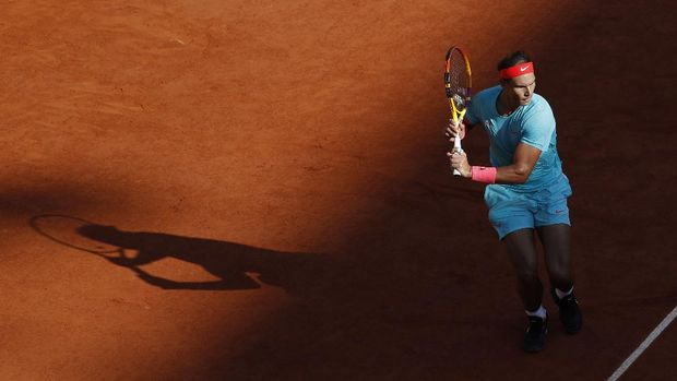 Spain's Rafael Nadal plays a shot against Argentina's Diego Schwartzman in the semifinal match of the French Open tennis tournament at the Roland Garros stadium in Paris, France, Friday, Oct. 9, 2020. (AP Photo/Alessandra Tarantino)