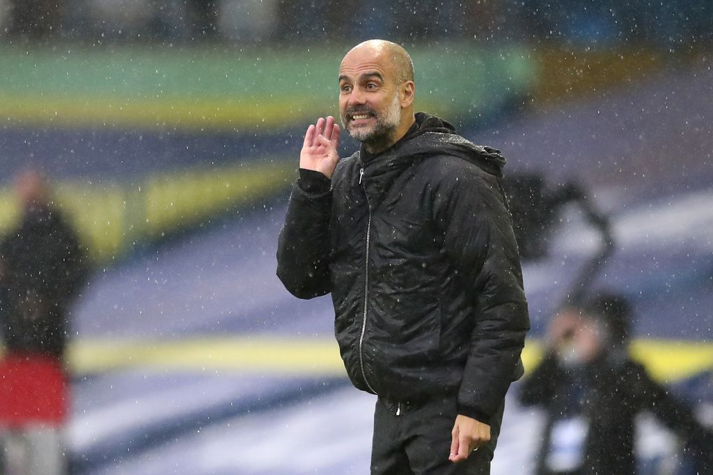 Manchester City's head coach Pep Guardiola gestures during the English Premier League soccer match between Leeds United and Manchester City at Elland Road in Leeds, England, Saturday, Oct. 3, 2020. (Cath Ivill/Pool via AP)