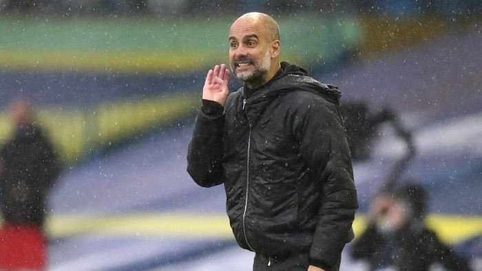 Manchester Citys head coach Pep Guardiola gestures during the English Premier League soccer match between Leeds United and Manchester City at Elland Road in Leeds, England, Saturday, Oct. 3, 2020. (Cath Ivill/Pool via AP)