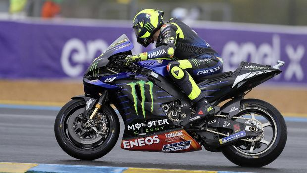 Italian rider Valentino Rossi of the Monster Energy Yamaha MotoGP steers his motorcycle during a warm up lap before the MotoGP race of the French Motorcycle Grand Prix at the Le Mans racetrack, in Le Mans, France, Sunday, Oct. 11, 2020. (AP Photo/David Vincent)