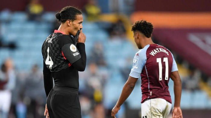 BIRMINGHAM, ENGLAND - OCTOBER 04: Virgil van Dijk of Liverpool reacts as Ollie Watkins of Aston Villa walks past him during the Premier League match between Aston Villa and Liverpool at Villa Park on October 04, 2020 in Birmingham, England. Sporting stadiums around the UK remain under strict restrictions due to the Coronavirus Pandemic as Government social distancing laws prohibit fans inside venues resulting in games being played behind closed doors. (Photo by Peter Powell - Pool/Getty Images)